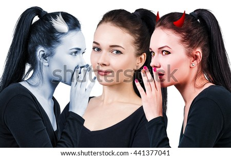 Beautiful young woman with angel and devil - stock photo