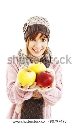 Beautiful young woman with apple. Winter style. Isolated on white background - stock photo