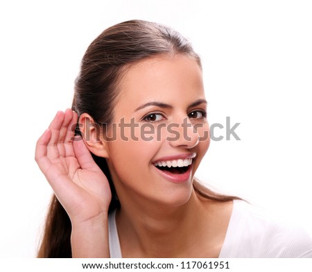 Beautiful young woman with attractive smile listening - stock photo