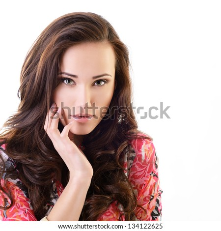 Beautiful young woman with beauty long brown hair posing at studio, face with hand portrait over white - stock photo