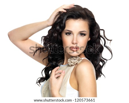 Beautiful  young woman with beauty long curly hair. Fashion model portrait isolated on white background - stock photo