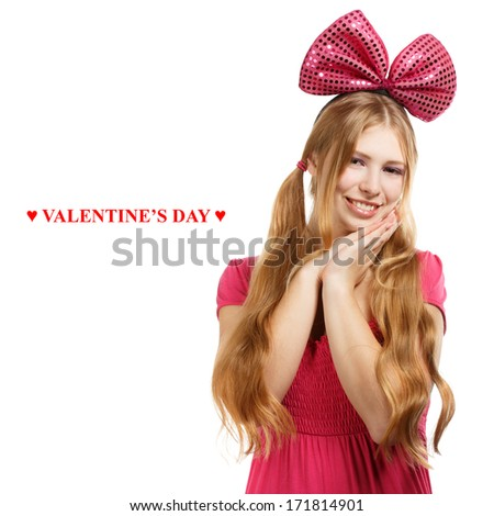 Beautiful young woman with big pink bow and ponytail hairstyle gesturing isolated on white background