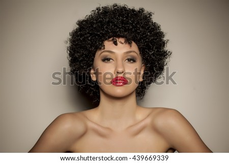 beautiful young woman with black curly wig