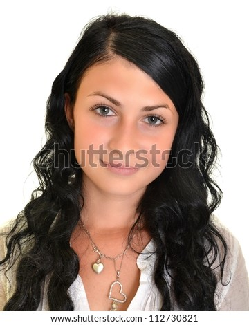 Beautiful young woman with black, long hair isolated on white - stock photo