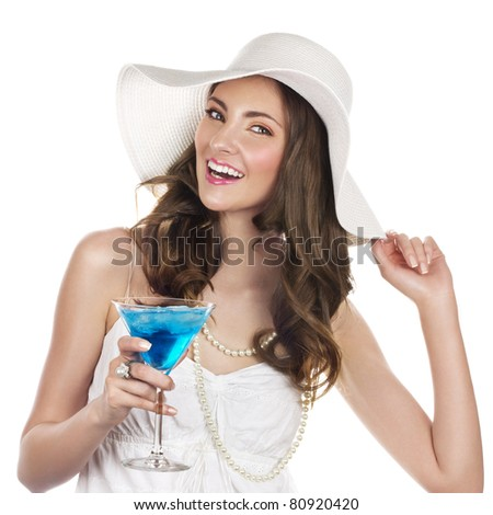 Beautiful young woman with blue cocktail - stock photo