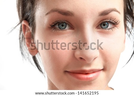 beautiful young woman with blue eyes - face close-up