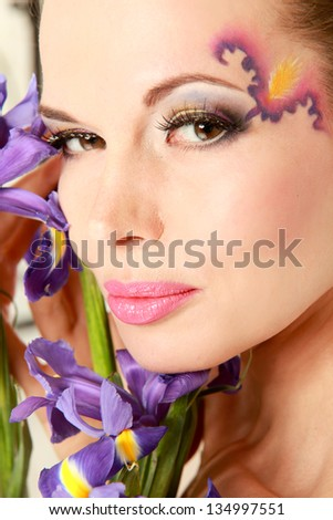 Beautiful young woman with blue flowers