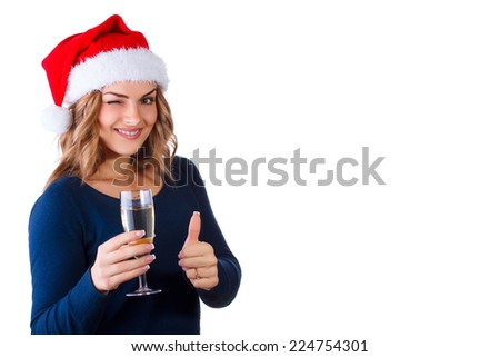 beautiful young woman with bottle of champagne in the hat of Santa Claus, isolated on white - stock photo