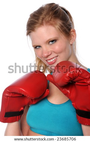 Beautiful young woman with boxing gloves - stock photo