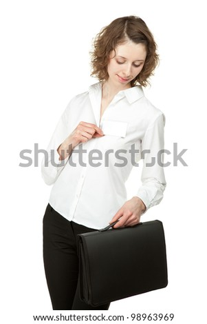 Beautiful young woman with briefcase showing blank name badge, you can write your text on it; studio shot isolated on white - stock photo