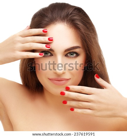 Beautiful young woman with bright make-up and manicure - stock photo