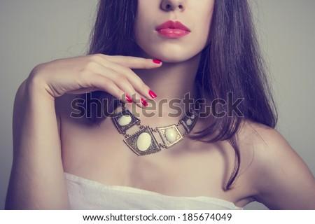 Beautiful young woman with bright makeup and manicure. Jewelry and Beauty. Fashion photo