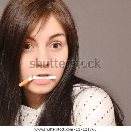 beautiful young woman with broken cigarette