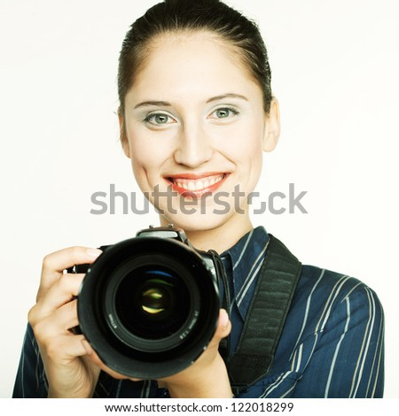 Beautiful young woman with camera - stock photo