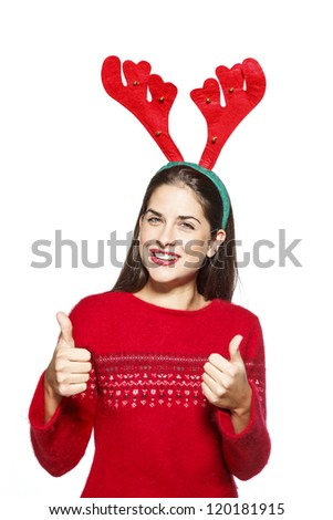 Beautiful young woman with Christmas reindeer ears, smiling and showing thumbs up gesture, santa claus. On white background - stock photo
