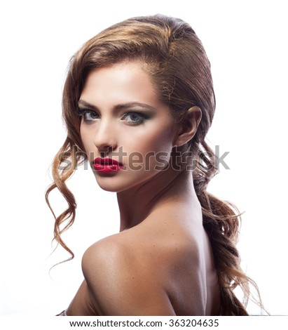 Beautiful young woman with classy makeup and hair - stock photo