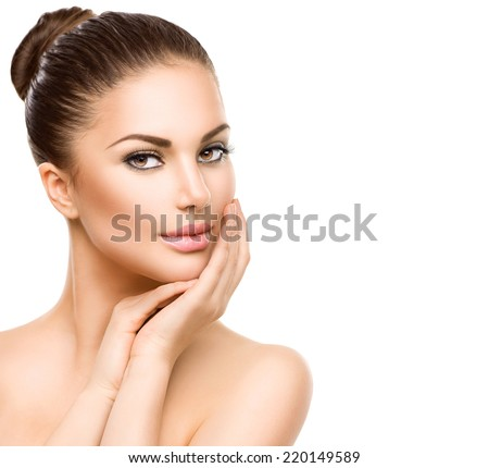 Beautiful Young Woman with Clean Fresh Skin close up isolated on white. Beauty Girl Portrait. Spa Woman Smiling and touching her skin. Perfect Fresh Skin. Face Model. Youth and Skin Care Concept  - stock photo