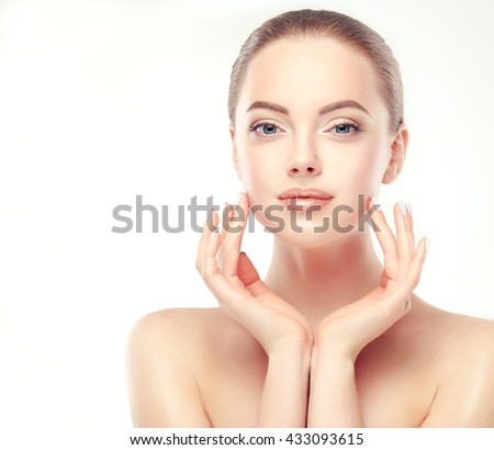 Beautiful Young Woman with Clean Fresh Skin . Facial  treatment   . Cosmetology , beauty  and spa .   - stock photo