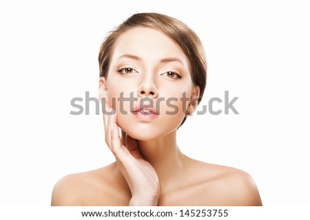 Beautiful young woman with clean fresh skin, hand next to her face