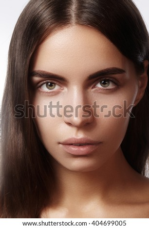 Beautiful young woman with clean skin, beautiful straight shiny hair, fashion makeup. Glamour make-up, perfect shape eyebrows. Portrait sexy brunette. Beautiful smooth hairstyle  - stock photo