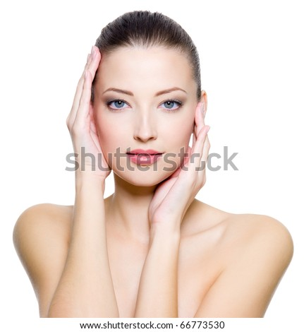 Beautiful young woman with clean skin of the face. Pretty female posing on white background - stock photo