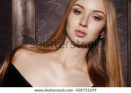 Beautiful young woman with clean skin, shiny blond straight hair, fashion makeup. Glamour make-up, perfect shape eyebrows. Portrait sexy blonde. Evening elegant style  - stock photo