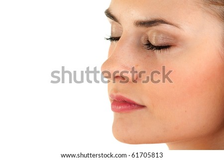 beautiful young woman with closed eyes, isolated