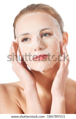 Beautiful young woman with collagen mask. Isolated on white. - stock photo