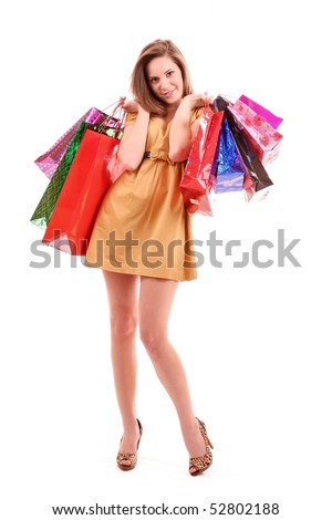 Beautiful young woman with color shopping bags in her hand. Isolated on white background.