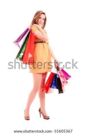 Beautiful young woman with color shopping bags in her hand. Isolated on white background