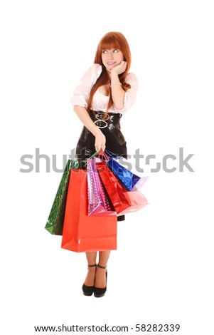 Beautiful young woman with color shopping bags in her hand. Isolated on white background - stock photo