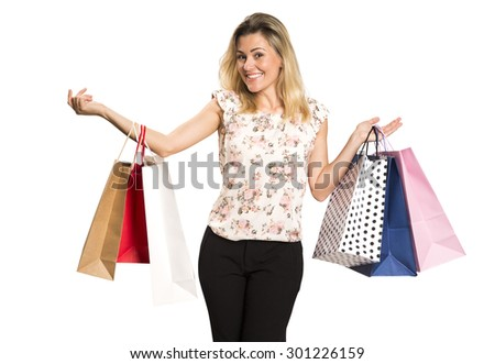 beautiful young woman with colored shopping bags over white background
