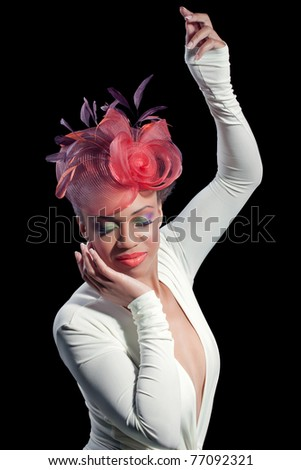 Beautiful young woman with colorful makeup wearing a stylish hat, isolated on back - stock photo