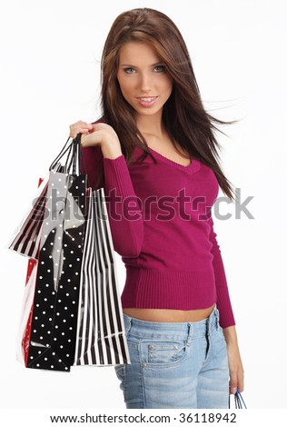 Beautiful, young  woman with colorful shopping bags