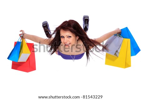 Beautiful, young, woman with colorful shopping bags in her hand flying - stock photo