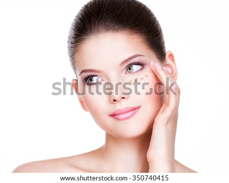 Beautiful young woman with cosmetic foundation on a skin. Beauty treatment concept. - stock photo