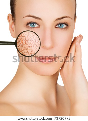 Beautiful young woman with cracked skin - stock photo