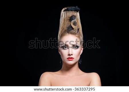 Beautiful young woman with creative fashion hairstyle. Carmen. Spanish flamenco hairstyle - stock photo