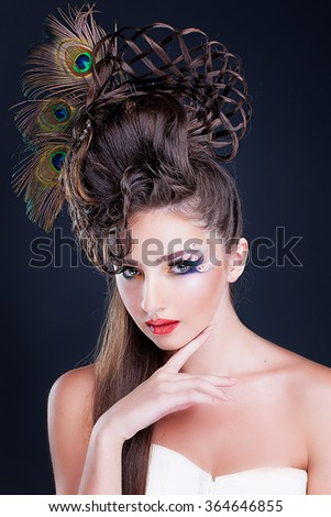 Beautiful young woman with creative fashion hairstyle. Spanish flamenco hairstyle - stock photo