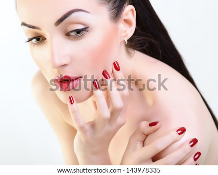 Beautiful young woman with creative makeup posing at studio over white background - stock photo