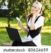 Beautiful Young Woman with Credit Card Using Her Laptop - stock photo