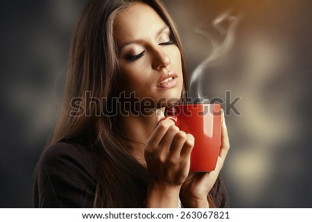 Beautiful young woman with cup of coffee - stock photo