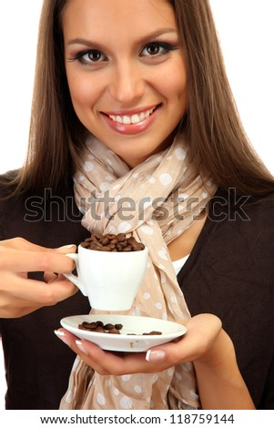 beautiful young woman with cup of coffee beans, isolated on white