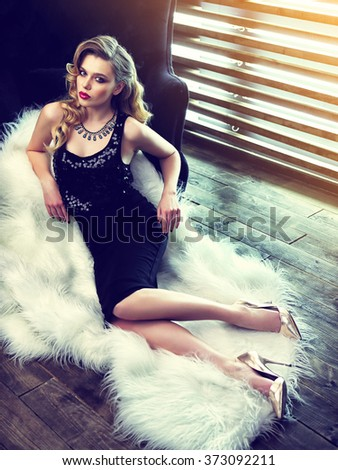 beautiful young woman with curly blond hair. Fashion shot. Retro fashion.  - stock photo