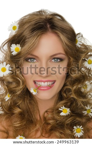 beautiful young woman with daisies in wavy hair and teeth - stock photo