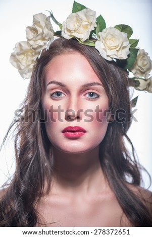 Beautiful young woman with delicate flowers in their hair. image of spring and the sun - stock photo
