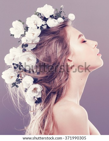 Beautiful young woman with delicate flowers in their hair, instagram filters - stock photo