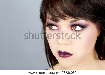 Beautiful young woman with dramatic makeup