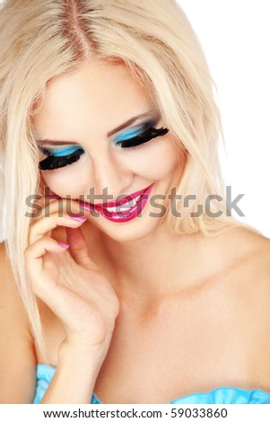Beautiful young woman with fashion make-up - stock photo