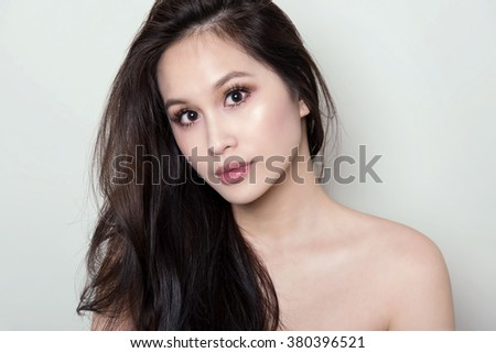 beautiful young woman with flawless skin and perfect make-up